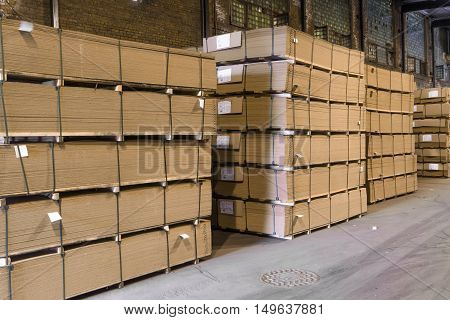 Paper manufacture storehouse. Pallets with ready products