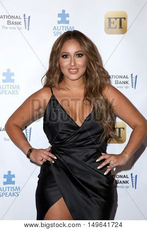 LOS ANGELES - SEP 29:  Adrienne Bailon at the Autism Speaks' La Vie En BLUE Fashion Gala at the Warner Brothers Studio on September 29, 2016 in Burbank, CA