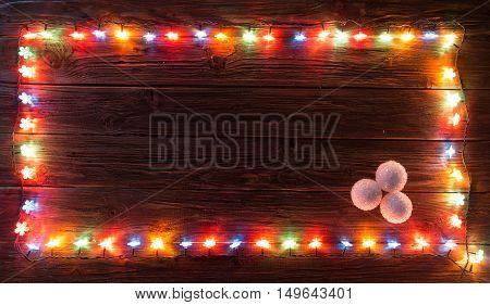 Christmas Light Decorations On Wood Texture