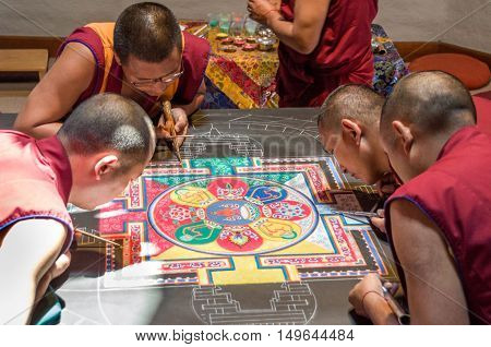 Tibetan Monks Making A Mandala