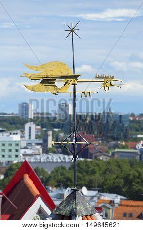 TALLINN, ESTONIA - AUGUST 01, 2015: The weather vane-cock above the city. Historical landmark of the city Tallinn, Estonia