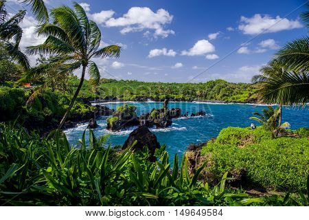 looking from the rugged lava coastline of waianapanapa state park toward the black sand beach near hana maui hawaii.