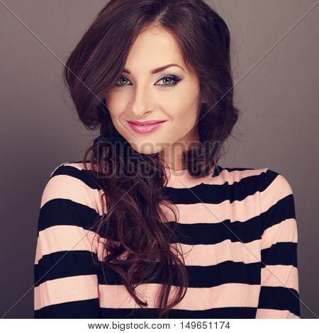 Happy Beautiful Casual Woman With Long Curly Hair Style Looking With Smile On Grey Background. Close