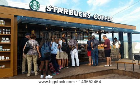 Monte-Carlo Monaco - September 26 2016: Customer Line Up For Buying Coffee Cakes Or Frappuccino At Starbucks In Monaco French Riviera