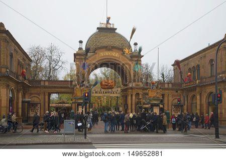 COPENHAGEN, DENMARK - NOVEMBER 01, 2014: The entrance in the park Tivoli during Halloween. Tourist landmark of the city Copenhagen, Denmark