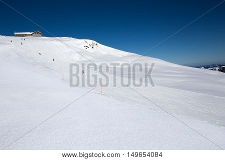 Skiers On The Slope From The Spirstock Peak In Hoch-ybrig Ski Resort, Swiss Alps, Schwyz, Central Sw