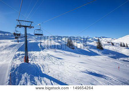 Skiers on the from the Spirstock peak in Hoch-Ybrig ski resort Swiss Alps Schwyz Central Switzerland