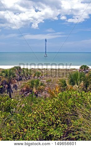 Water tower in the middle of the ocean on a sunny day, Fort De Soto, Florida
