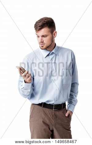 Portrait of businessman in doubt, skeptical and looks at the phone, isolated on white background