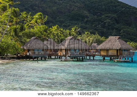 Over water bungalows in Moorea French Polynesia. A dreamed destination for honeymoon. The color of the water in the sea is stunning.