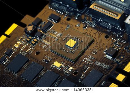 Close-up of electronic circuit board with processor and other components. Special colors futuristic image.