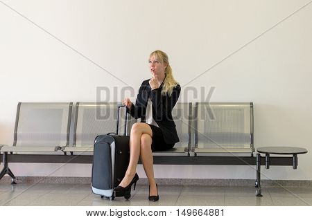 Concerned Young Businesswoman Waiting For A Flight