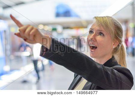 Surprised Woman Pointing Upwards