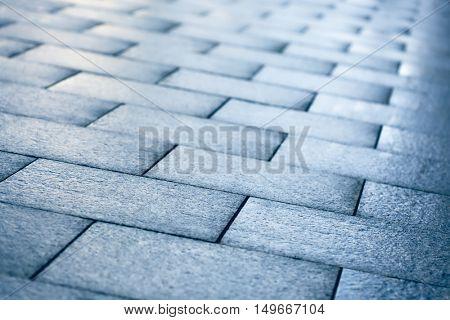 Wet road tiles shallow depth of field, outdoor shoot
