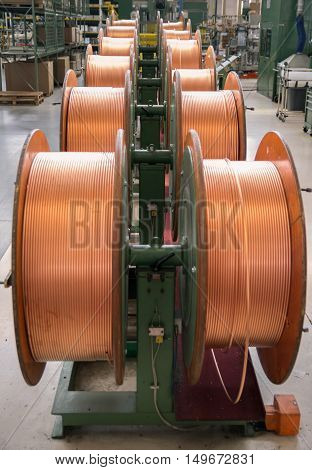 Copper tubes for bending machine in a factory.