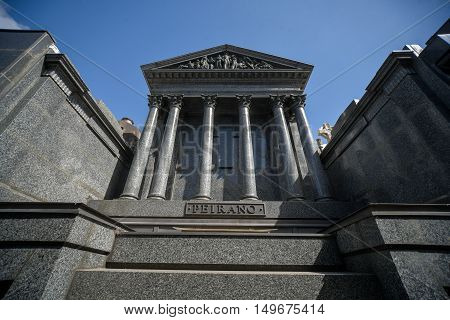 Buenos Aires Argentina - Sept 23 2016: View of a tomb with a сolonnade at the La Recoleta Cemetery in Capital Federal.