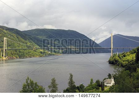 HERLAND, NORWAY - JULY 3, 2016: It is a modern cable-stayed road bridge over the sea strait to the island of Osteroy.