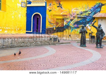 CARTAGENA COLOMBIA - MAY 24: View of statues and a mural in Santisima Trinidad Plaza in Cartagena Colombia on May 24 2016
