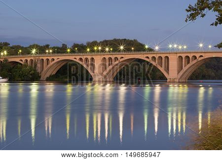 Key Bridge at sunrise in Washington Dc USA. Bridge over Potomac River with reflections at dusk.
