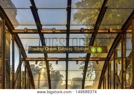 Outdoors glass entrance to the 4/5 Bowling Green Subway Station in downtown Manhattan in New York City.