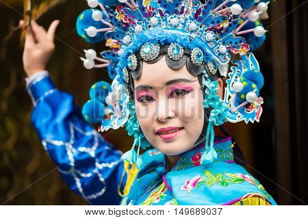Chengdu Sichuan Province China - Dec 11 2015 : Portrait of a young woman dressed in Sichuan Opera traditional costume in Kuan and Zhai alley touristic area.