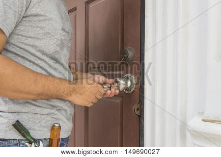 locksmith try to open old wood door with his tools - can use to display or montage on products