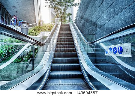 Escalators and stairs next to the buildings in Guangzhou, China