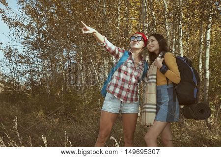 Two Young Woman Europian And Asian Walking And  Looking On A Nature