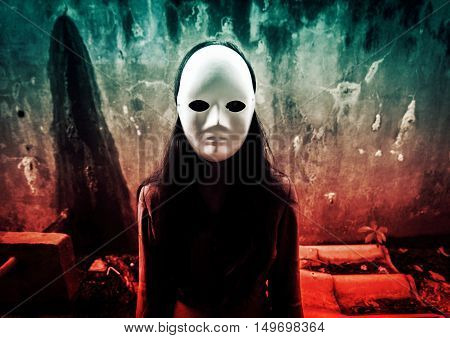 Face of mysterious woman in black dress wearing white mask,Scary background for book cover