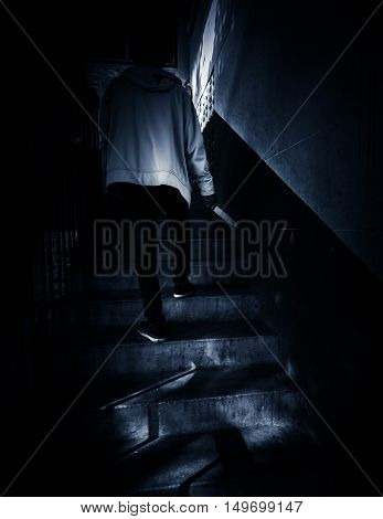 An intruder with knife in hand,Scary background for book cover ideas