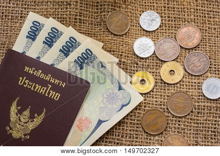 Yen Money And Yen Coin With Passport On Sack Background For Travel Or Business Concept