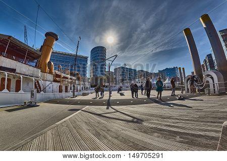 HAMBURG, GERMANY - MARCH 26, 2016: Tourists visit marina in new harbor city