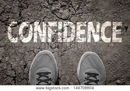 Top View of Sneakers on dry land with the text: Confidence