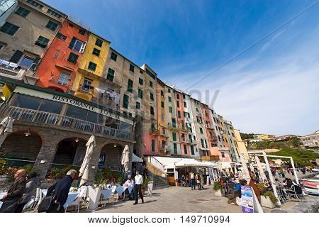 PORTOVENERE ITALY - MARCH 25 2016: Tourists on the promenade of Portovenere or Porto Venere (UNESCO world heritage site). La Spezia Liguria Italy