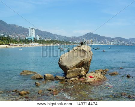 The Statue of Siren on the rock on the coast of Acapulco Mexico.