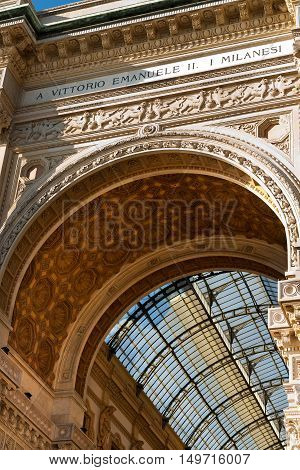 Entrance from Duomo Square of the Vittorio Emanuele II Gallery famous shopping center with glass dome and ornaments in Milan Milano Italy
