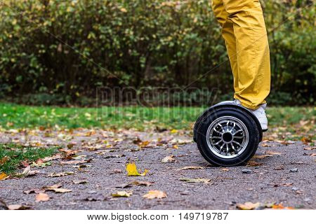 man standing with hoverboard on the street