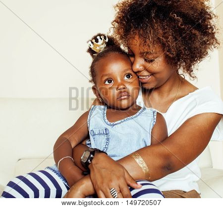 adorable sweet young afro-american mother with cute little daughter, hanging at home, having fun playing smiling, lifestyle people concept, queen girl