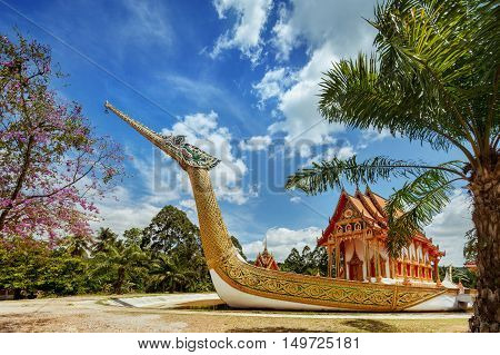 Thai temple built in the ark on the tropic background. Phangnga province. Thailand
