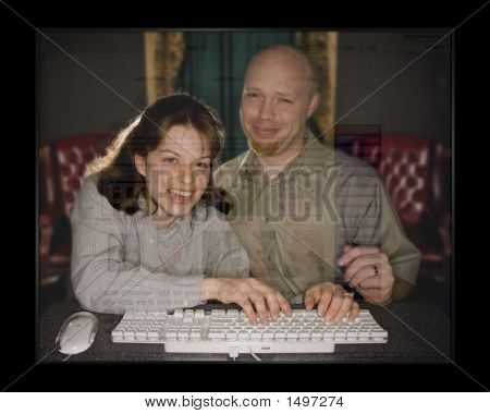 Man And Woman Working On Computer 2