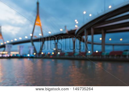 Blurred lights over suspension bridged waterfront, abstract background