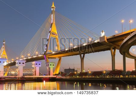 Suspension Bridge over watergate with clear blue sky at twilight, Bangkok Thailand