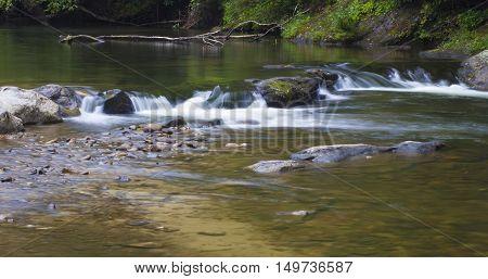 Upstream portion of Wilson Creek running over rocks in North Carolina