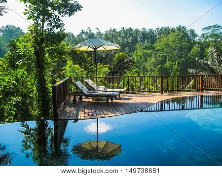 Bali, Indonesia - April 14, 2014: View of swimming pool at Nandini Bali Jungle Resort and Spa.