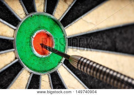 one dart in bull's eye close up