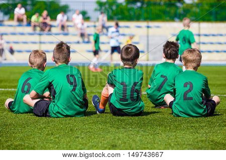 Football team. Soccer players. Football match for children. Training and football soccer tournament. Sports youth teams competition.