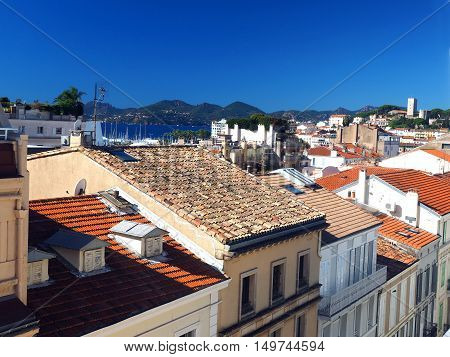 rooftop view of Cannes France French Riviera old town fort in background
