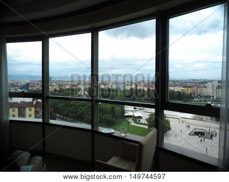 view of Central Park fountains National Palace of Culture and cityscape of Sofia Bulgaria from hotel suite
