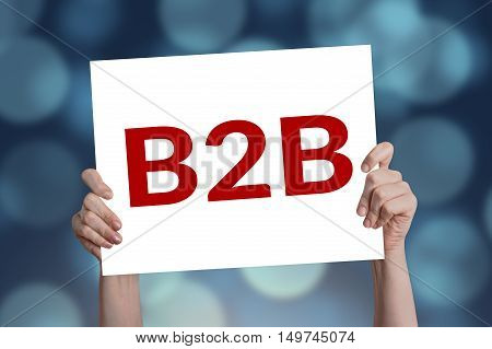 B2B (marketing) card in hand with bokeh background