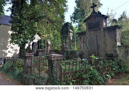 PRAGUE CZECH REPUBLIC - SEPTEMBER 29 2016: Statues and graves on old Olsany Cemeteries - largest graveyard in Prague
